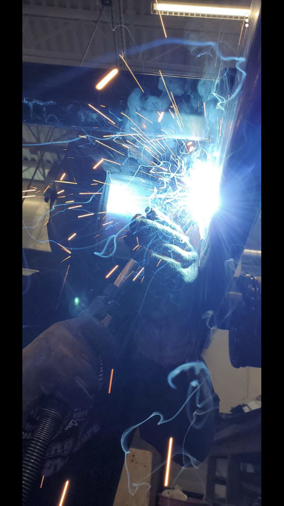 Here's an old picture of me welding the axles on Mr. Carlsons dump trailer